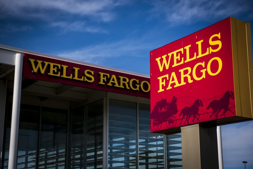 Signage is displayed outside a Wells Fargo & Co. bank branch in Niles, Illinois, U.S., on Tuesday, July 10, 2018. Wells Fargo & Co. is scheduled to release earnings figures on July 13. Photographer: Christopher Dilts/Bloomberg