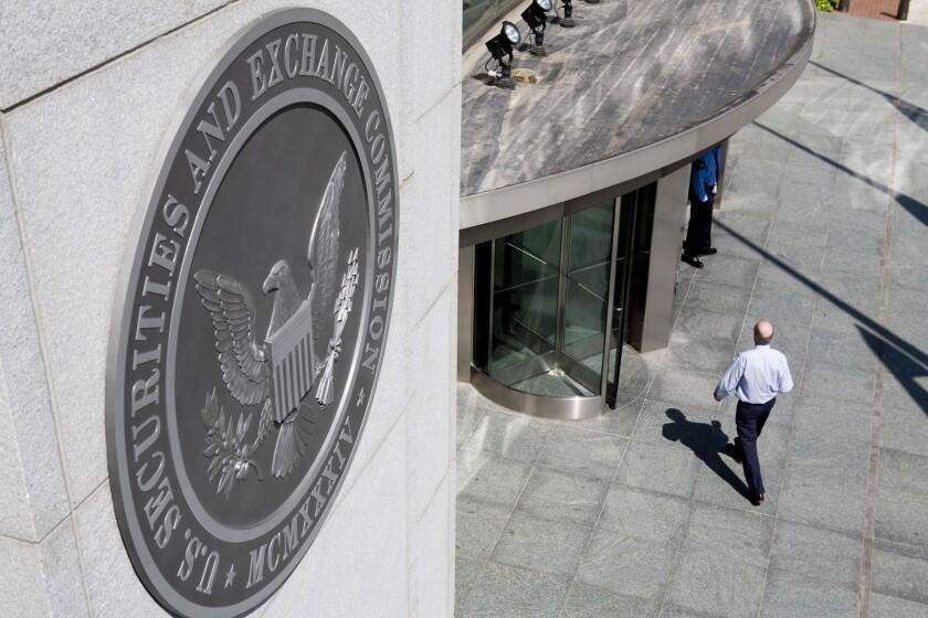 SEC man walking by Bloomberg News