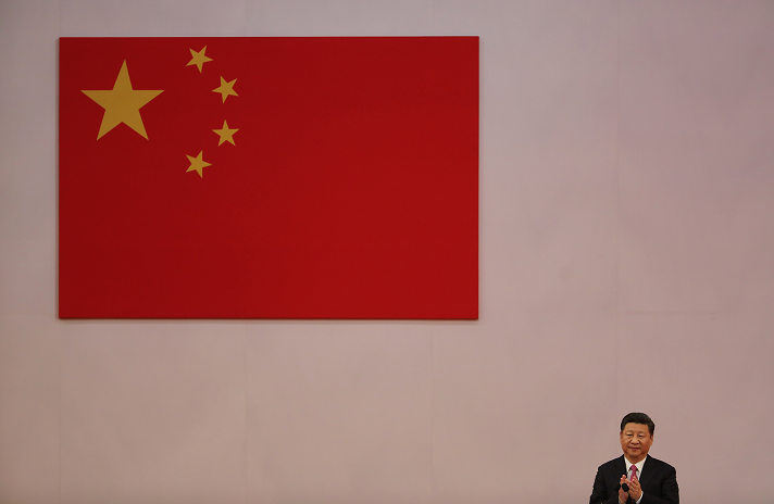 Xi Jinping, China's president, applauds during a swearing-in ceremony in Hong Kong, China, on Saturday, July 1, 2017.